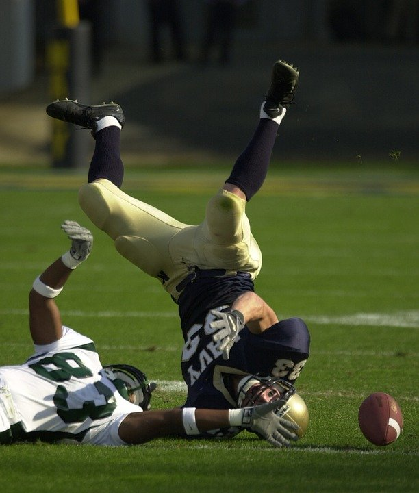 A football player landing on his head