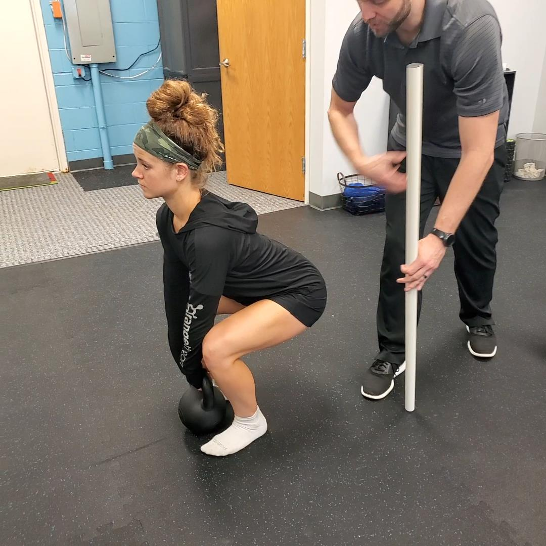 Coaching how to deadlift and squat.