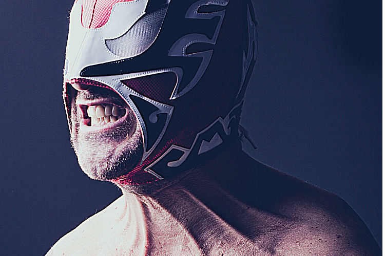 A pro-wrestler clenching his jaw.