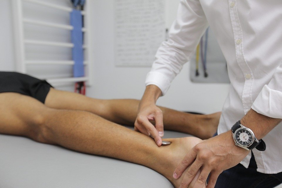 A leg being treated with a scraping technique