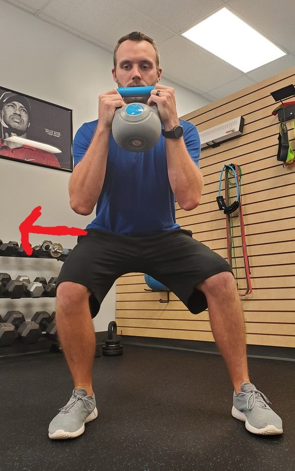 Shifting weight during a squat.